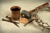 picture of communion  - Communion elements with crown of thorns and nails over vintage cloth - JPG
