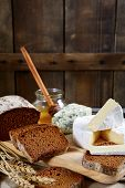 picture of brie cheese  - Brie cheese bread slices roquefort and honey on a wooden background - JPG