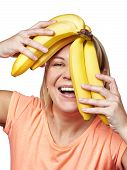 stock photo of snatch  - Happy and healthy woman with bananas isolated - JPG