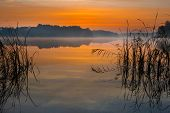 picture of reflection  - Beautiful lake sunrise with sky reflections in water - JPG