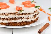 foto of carrot  - Tasty easter carrot cake with cream and little carrots on white plate background - JPG