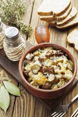 picture of stew pot  - Kidney stewed with potatoes and pickles in a ceramic pot - JPG