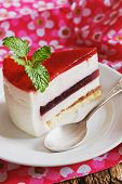 picture of cream puff  - piece of cake with a cream puff on a plate on a festive background - JPG
