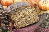 picture of fall decorations  - Delicious banana nut bread closeup with fall decorations focus on bread perfect for Thanksgiving - JPG
