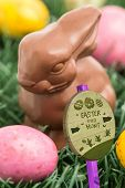 picture of easter eggs bunny  - Easter egg hunt sign against colourful easter eggs with chocolate bunny - JPG
