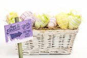 image of easter basket  - Easter egg hunt sign against many easter eggs in basket - JPG