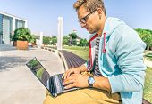 pic of computer hacker  - Young attractive man with laptop computer outdoors  - JPG