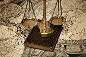 picture of cartographer  - Scale of justice on old map more than 300 years old - JPG