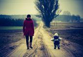 pic of children walking  - Mother with child walking by rural sandy road - JPG