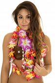 stock photo of hula dancer  - A Hawaiian woman in her coconut bra with her lei around her neck with a small smile - JPG