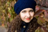 picture of beret  - Portrait of young beautiful brunette in blue beret - JPG