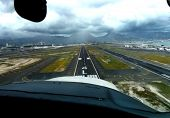 image of cessna  - landing a tourist plane in honolulu international airport  - JPG