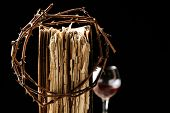 stock photo of crown-of-thorns  - Crown of thorns and bible on black background - JPG