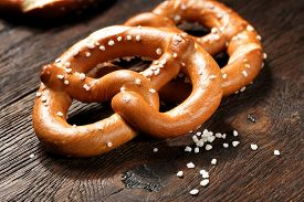 stock photo of pretzels  - Fresh pretzels with sea salt close - JPG