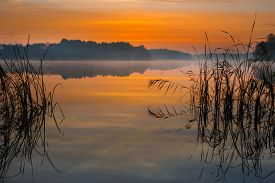 picture of reflections  - Beautiful lake sunrise with sky reflections in water - JPG