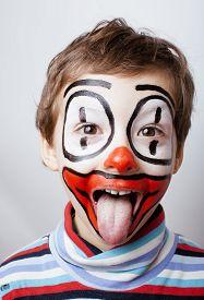 foto of pantomime  - little cute real boy with facepaint like clown - JPG