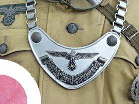 stock photo of swastika  - Breastplate of military gendarmerie in the German troops of times of World War II - JPG