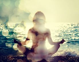 pic of yoga  - Woman Practicing Yoga by the Sea - JPG