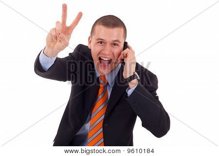 Man Making Victory Sign On Phone