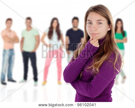 Confused teenager girl thinking with unfocused people of background