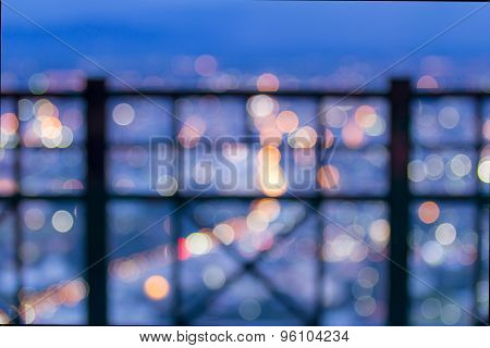 Blurred City Light Look Through Railing