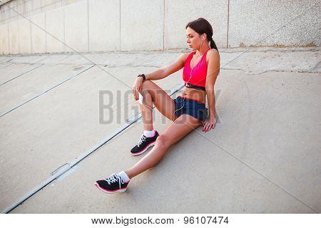 sitting runner woman listening music