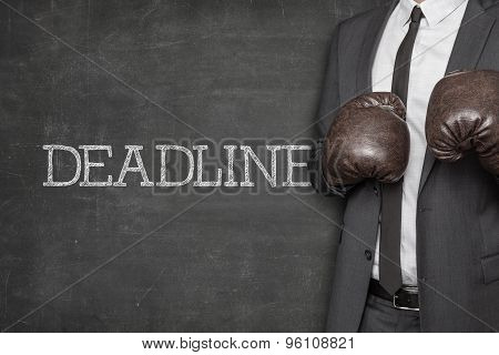 Deadline on blackboard with businessman