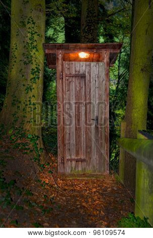 Wooden Dry Toilet House At Night In The Forest