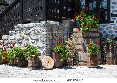 Flower decorations and part of Old stone traditional bulgarian wall