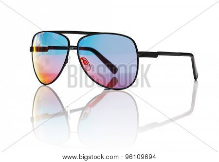Sunglasses on a white reflective background.