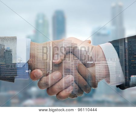 business, partnership, cooperation and gesture concept - businessman and businesswoman shaking hands over city double exposure background