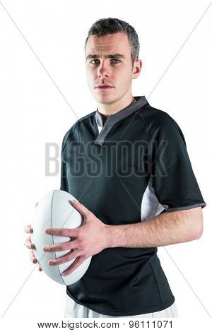 Portrait of a rugby player holding a rugby ball