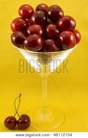 Red Sweet Cherries In A Glass