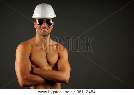 Portrait of builder in a helmet