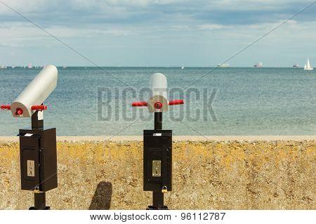 Watching Sea Trought Binoculars Telescope On Pier