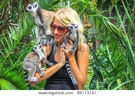 Woman plays with lemurs