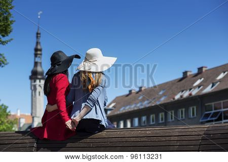 Two Female Friends Tenderly Holding Hands Together