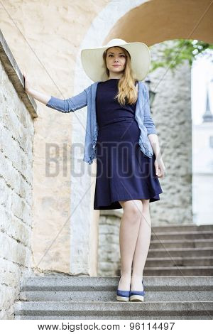 Young Blonde Woman Standing On The Stairs
