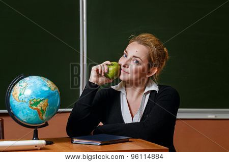 Geography Teacher Holding A Green Apple.