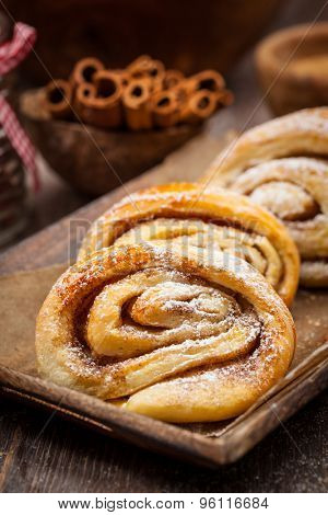 Homemade cinnamon rolls on wooden table