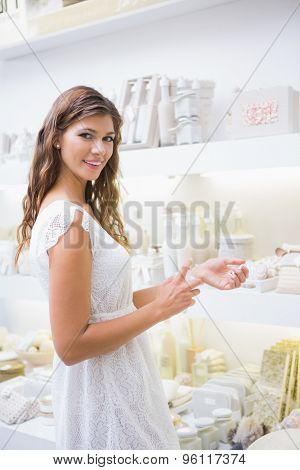 Portrait of smiling woman testing products at a beauty salon