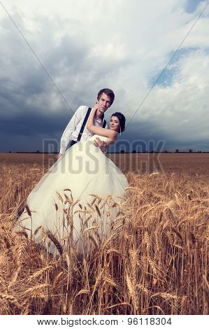 Beautiful Young Bride And Groom In Wheat Field