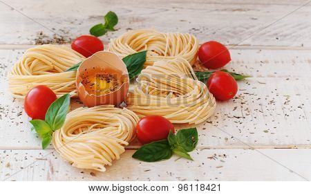 raw egg and noodles with spices