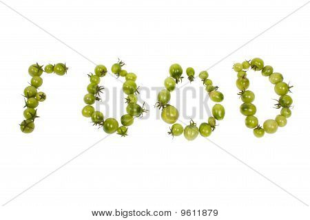 Letters made up by green tomatoes
