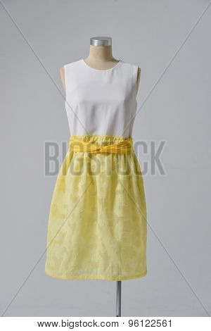Woman yellow clothes on mannequin isolated