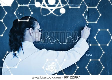 Science graphic against darkhaired scientist drawing a graph on the blackboard