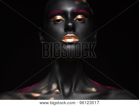 fashion portrait of a dark-skinned girl with color make-up. Beauty face.