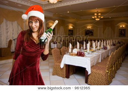 Girl In A Christmas Hat With Champagne