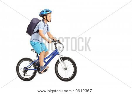Studio shot of a schoolboy with a helmet and a blue backpack riding a bike isolated on white background