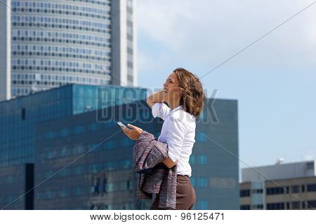 Smiling Business Woman Walking In The City With Cell Phone